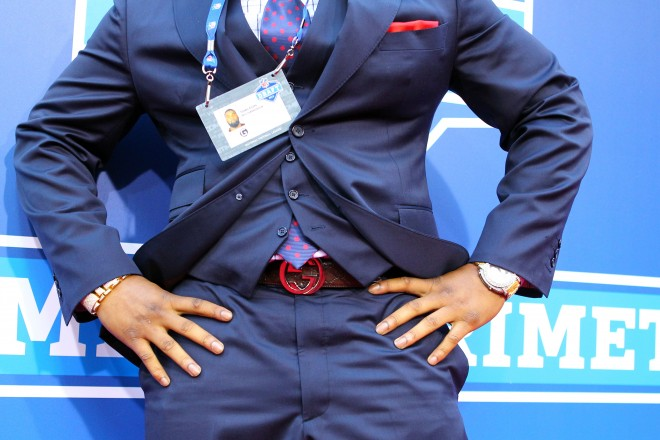 Style at the NFL draft means belts, vests, earrings, and lots of bling on the watch.